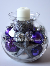 a diy christmas wedding centerpiece with a candle