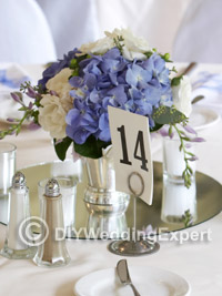 An idea for a diy wedding centerpiece featuring flowers.