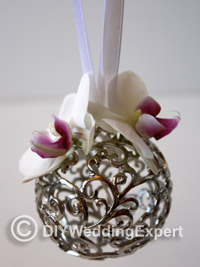 orchids attached to a pomander ball for a diy wedding project